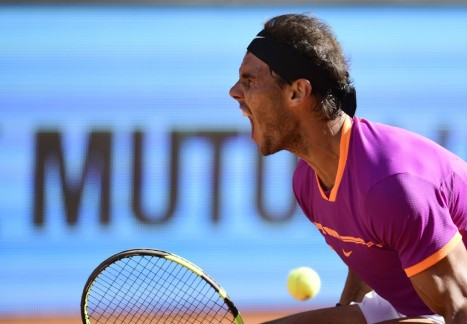 Spanish tennis player Rafael Nadal celebrates the last point against Serbian tennis player Novak Djokovic during their ATP Madrid Open semifinal match in Madrid, on May 13, 2017..Nadal won 6-2 and 6-4. / AFP PHOTO / JAVIER SORIANO (May 12, 2017 - Source: AFP)