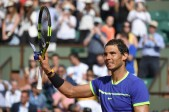Spain's Rafael Nadal celebrates after winning his tennis match against Netherlands' Robin Haase at the Roland Garros 2017 French Open on May 31, 2017 in Paris. / AFP PHOTO / Eric FEFERBERG (May 30, 2017 - Source: AFP)