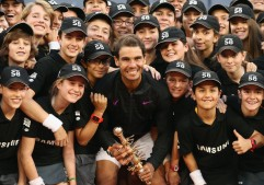 Rafael Nadal of Spain with the winners trophy alongside the ball boys and girls after his win over Dominic Thiem of Austria in the final during day nine of the Mutua Madrid Open tennis at La Caja Magica on May 14, 2017 in Madrid, Spain. (May 13, 2017 - Source: Julian Finney/Getty Images Europe)