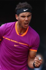 Rafael Nadal of Spain celebrates winning a game against Dominic Thiem of Austria in the final during day nine of the Mutua Madrid Open tennis at La Caja Magica on May 14, 2017 in Madrid, Spain. (May 13, 2017 - Source: Julian Finney/Getty Images Europe)