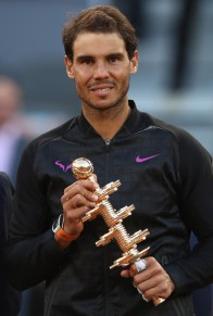 Rafael Nadal of Spain with the winners trophy after his win over Dominic Thiem of Austria in the final during day nine of the Mutua Madrid Open tennis at La Caja Magica on May 14, 2017 in Madrid, Spain. (May 13, 2017 - Source: Julian Finney/Getty Images Europe)
