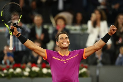 Rafael Nadal of Spain celebrates defeating Nick Kyrgios of Australia during day six of the Mutua Madrid Open tennis at La Caja Magica on May 11, 2017 in Madrid, Spain. (May 10, 2017 - Source: Julian Finney/Getty Images Europe)