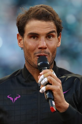 Rafael Nadal of Spain thanks the crowd after his win over Dominic Thiem of Austria in the final during day nine of the Mutua Madrid Open tennis at La Caja Magica on May 14, 2017 in Madrid, Spain. (May 13, 2017 - Source: Julian Finney/Getty Images Europe)