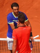 Rafael Nadal of Spain shakes hands with Benoit Paire of France following the mens singles first round match on day two of the 2017 French Open at Roland Garros on May 29, 2017 in Paris, France. (May 28, 2017 - Source: Clive Brunskill/Getty Images Europe)