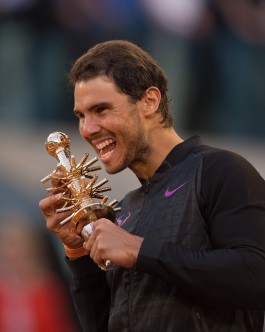 Rafael Nadal of Spain celebrates with the trophy after beating Dominic Thiem of Austria in the men's final at La Caja Magica on May 14, 2017 in Madrid, Spain. (May 13, 2017 - Source: Denis Doyle/Getty Images Europe)