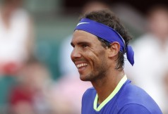 Spain's Rafael Nadal smiles after defeating Georgia's Nikoloz Basilashvili during their third round match of the French Open tennis tournament at the Roland Garros stadium, Friday, June 2, 2017 in Paris. Nadal won 6-0, 6-1, 6-0. (Petr David Josek/Associated Press)