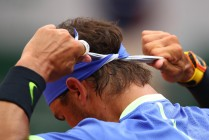 Rafael Nadal of Spain adjusts his headband during the men's singles third round match against Nikoloz Basilashvili of Georgia on day six of the 2017 French Open at Roland Garros on June 2, 2017 in Paris, France. (June 1, 2017 - Source: Clive Brunskill/Getty Images Europe)