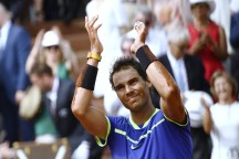 Spain's Rafael Nadal celebrates after winning the men's final tennis match against Switzerland's Stanislas Wawrinka at the Roland Garros 2017 French Open on June 11, 2017 in Paris. / AFP PHOTO / CHRISTOPHE SIMON (June 10, 2017 - Source: AFP)