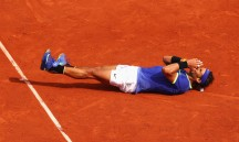 Rafael Nadal of Spain celebrates match point and victory during the men's singles final against Stan Wawrinka of Switzerland on day fifteen of the French Open at Roland Garros on June 11, 2017 in Paris, France. (June 10, 2017 - Source: Clive Brunskill/Getty Images Europe)