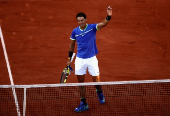 Rafael Nadal of Spain celebrates victory following the mens singles semi-final match against Dominic Thiem of Austria on day thirteen of the 2017 French Open at Roland Garros on June 9, 2017 in Paris, France. (June 8, 2017 - Source: Adam Pretty/Getty Images Europe)