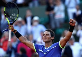 Rafael Nadal of Spain celebrates victory following the mens singles semi-final match against Dominic Thiem of Austria on day thirteen of the 2017 French Open at Roland Garros on June 9, 2017 in Paris, France. (June 8, 2017 - Source: Julian Finney/Getty Images Europe)