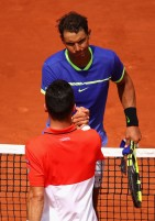 Roberto Bautista Agut of Spain congratulates Rafael Nadal of Spain on victory following the mens singles fourth round match on day eight of the 2017 French Open at Roland Garros on June 4, 2017 in Paris, France. (June 3, 2017 - Source: Clive Brunskill/Getty Images Europe)
