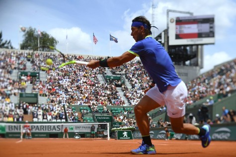 A photo taken with a tilt and shift lens shows Spain's Rafael Nadal returning the ball to Spain's Roberto Bautista Agut during their tennis match at the Roland Garros 2017 French Open on June 4, 2017 in Paris. / AFP PHOTO / GABRIEL BOUYS (June 3, 2017 - Source: AFP)