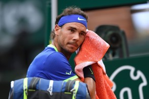 Spain's Rafael Nadal wipes his face as he plays against Georgia's Nikoloz Basilashvili during their tennis match at the Roland Garros 2017 French Open on June 2, 2017 in Paris. / AFP PHOTO / Lionel Bonaventure (June 1, 2017 - Source: AFP)