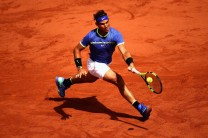 Rafael Nadal of Spain plays a forehand during mens singles quarter finals match against Pablo Carreno Busta of Spain on day eleven of the 2017 French Open at Roland Garros on June 7, 2017 in Paris, France. (June 6, 2017 - Source: Julian Finney/Getty Images Europe)