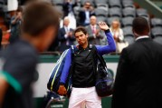 Rafael Nadal of Spain leaves the court following victory in the mens singles quarter finals match against Pablo Carreno Busta of Spain on day eleven of the 2017 French Open at Roland Garros on June 7, 2017 in Paris, France. (June 6, 2017 - Source: Adam Pretty/Getty Images Europe)