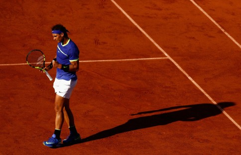 Rafael Nadal of Spain celebrates during the mens singles semi-final match against Dominic Thiem of Austria on day thirteen of the 2017 French Open at Roland Garros on June 9, 2017 in Paris, France. (June 8, 2017 - Source: Adam Pretty/Getty Images Europe)