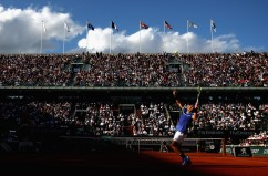 A general view inside Court Philippe Chatrier as Rafael Nadal of Spain serves during the mens singles semi-final match against Dominic Thiem of Austria on day thirteen of the 2017 French Open at Roland Garros on June 9, 2017 in Paris, France. (June 8, 2017 - Source: Julian Finney/Getty Images Europe)
