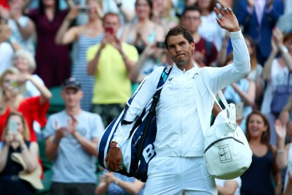 Rafael Nadal of Spain acknowledges the crowd after his Gentlemen's Singles second round match against Donald Young of The United States on day three of the Wimbledon Lawn Tennis Championships at the All England Lawn Tennis and Croquet Club on July 5, 2017 in London, England. (July 4, 2017 - Source: Clive Brunskill/Getty Images Europe)