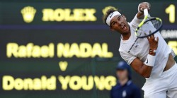 Spain's Rafael Nadal serves against US player Donald Young during their men's singles second round match on the third day of the 2017 Wimbledon Championships at The All England Lawn Tennis Club in Wimbledon, southwest London, on July 5, 2017. / AFP PHOTO / Adrian DENNIS / RESTRICTED TO EDITORIAL USE (July 4, 2017 - Source: AFP)