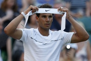 Spain's Rafael Nadal chages his head band during a break in play against US player Donald Young during their men's singles second round match on the third day of the 2017 Wimbledon Championships at The All England Lawn Tennis Club in Wimbledon, southwest London, on July 5, 2017. / AFP PHOTO / Adrian DENNIS / RESTRICTED TO EDITORIAL USE (July 4, 2017 - Source: AFP)