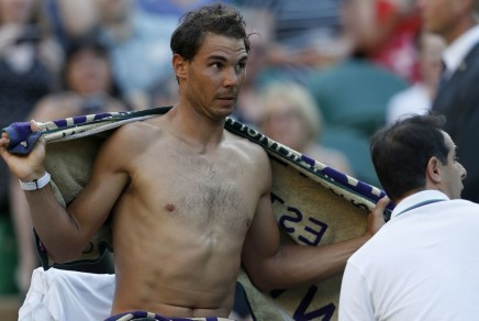 Spain's Rafael Nadal uses a towel as he changes his t-shirt during a break in play against US player Donald Young during their men's singles second round match on the third day of the 2017 Wimbledon Championships at The All England Lawn Tennis Club in Wimbledon, southwest London, on July 5, 2017. / AFP PHOTO / Adrian DENNIS / RESTRICTED TO EDITORIAL USE (July 4, 2017 - Source: AFP)
