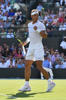 Spain's Rafael Nadal celebrates beating Australia's John Millman during their men's singles first round match on the first day of the 2017 Wimbledon Championships at The All England Lawn Tennis Club in Wimbledon, southwest London, on July 3, 2017. / AFP PHOTO / Glyn KIRK / RESTRICTED TO EDITORIAL USE (July 2, 2017 - Source: AFP)