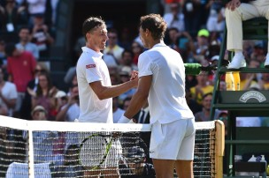 Spain's Rafael Nadal (R) shakes hands with Australia's John Millman (L) after Nadal won their men's singles first round match on the first day of the 2017 Wimbledon Championships at The All England Lawn Tennis Club in Wimbledon, southwest London, on July 3, 2017. / AFP PHOTO / Glyn KIRK / RESTRICTED TO EDITORIAL USE (July 2, 2017 - Source: AFP)