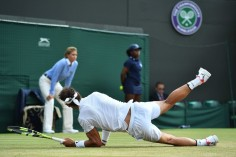 Spain's Rafael Nadal falls after diving to play a shot to Luxembourg's Gilles Muller during their men's singles fourth round match on the seventh day of the 2017 Wimbledon Championships at The All England Lawn Tennis Club in Wimbledon, southwest London, on July 10, 2017. / AFP PHOTO / Glyn KIRK / RESTRICTED TO EDITORIAL USE (July 9, 2017 - Source: AFP)