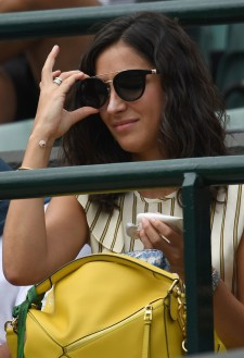 Xisca Perello, girlfriend of Spain's Rafael Nadal, watches Nadal play against Luxembourg's Gilles Muller during their men's singles fourth round match on the seventh day of the 2017 Wimbledon Championships at The All England Lawn Tennis Club in Wimbledon, southwest London, on July 10, 2017. / AFP PHOTO / Glyn KIRK / RESTRICTED TO EDITORIAL USE (July 9, 2017 - Source: AFP)