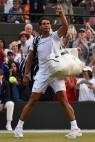 Spain's Rafael Nadal waves to the fans after losing aginst Luxembourg's Gilles Muller in their men's singles fourth round match on the seventh day of the 2017 Wimbledon Championships at The All England Lawn Tennis Club in Wimbledon, southwest London, on July 10, 2017..Muller won the match 6-3, 6-4, 3-6, 4-6, 15-13. / AFP PHOTO / Glyn KIRK / RESTRICTED TO EDITORIAL USE (July 9, 2017 - Source: AFP)
