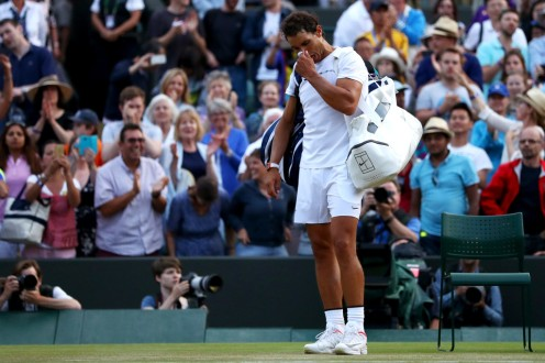 Rafael Nadal of Spain looks dejected in defeat after the Gentlemen's Singles fourth round match against Gilles Muller of Luxembourg on day seven of the Wimbledon Lawn Tennis Championships at the All England Lawn Tennis and Croquet Club on July 10, 2017 in London, England. (July 9, 2017 - Source: Michael Steele/Getty Images Europe)