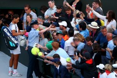 Rafael Nadal of Spain signs autographs in defeat after the Gentlemen's Singles fourth round match against Gilles Muller of Luxembourg on day seven of the Wimbledon Lawn Tennis Championships at the All England Lawn Tennis and Croquet Club on July 10, 2017 in London, England. (July 9, 2017 - Source: Clive Brunskill/Getty Images Europe)