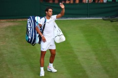 Rafael Nadal of Spain looks acknowledges the crowd in defeat after the Gentlemen's Singles fourth round match against Gilles Muller of Luxembourg on day seven of the Wimbledon Lawn Tennis Championships at the All England Lawn Tennis and Croquet Club on July 10, 2017 in London, England. (July 9, 2017 - Source: Clive Brunskill/Getty Images Europe)