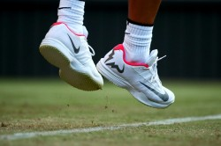 Shoe detail of Rafael Nadal of Spain as he serves during the Gentlemen's Singles second round match against Donald Young of The United States on day three of the Wimbledon Lawn Tennis Championships at the All England Lawn Tennis and Croquet Club on July 5, 2017 in London, England. (July 4, 2017 - Source: Clive Brunskill/Getty Images Europe)