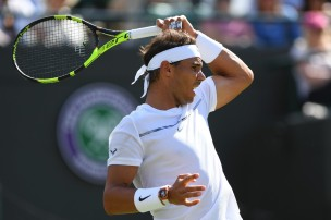 Spain's Rafael Nadal returns against Australia's John Millman during their men's singles first round match on the first day of the 2017 Wimbledon Championships at The All England Lawn Tennis Club in Wimbledon, southwest London, on July 3, 2017. / AFP PHOTO / Glyn KIRK / RESTRICTED TO EDITORIAL USE (July 2, 2017 - Source: AFP)