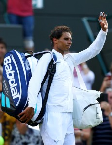 Rafael Nadal of Spain waves to the fans after the Gentlemen's Singles first round match against John Millman of Australia on day one of the Wimbledon Lawn Tennis Championships at the All England Lawn Tennis and Croquet Club on July 3, 2017 in London, England. (July 2, 2017 - Source: Michael Steele/Getty Images Europe)