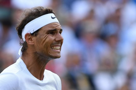TOPSHOT - Spain's Rafael Nadal reacts against Luxembourg's Gilles Muller during their men's singles fourth round match on the seventh day of the 2017 Wimbledon Championships at The All England Lawn Tennis Club in Wimbledon, southwest London, on July 10, 2017. / AFP PHOTO / Glyn KIRK / RESTRICTED TO EDITORIAL USE (July 9, 2017 - Source: AFP)