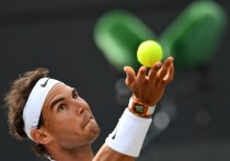 Spain's Rafael Nadal serves to Luxembourg's Gilles Muller during their men's singles fourth round match on the seventh day of the 2017 Wimbledon Championships at The All England Lawn Tennis Club in Wimbledon, southwest London, on July 10, 2017. / AFP PHOTO / Glyn KIRK / RESTRICTED TO EDITORIAL USE (July 9, 2017 - Source: AFP)
