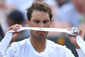 Spain's Rafael Nadal changes his headband during a break in play against Luxembourg's Gilles Muller during their men's singles fourth round match on the seventh day of the 2017 Wimbledon Championships at The All England Lawn Tennis Club in Wimbledon, southwest London, on July 10, 2017. / AFP PHOTO / Glyn KIRK / RESTRICTED TO EDITORIAL USE (July 9, 2017 - Source: AFP)