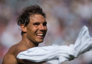 LONDON, ENGLAND - JULY 03: Rafael Nadal of Spain pretends to throw his shirt in to the crowd after his first round match against John Millman of Australia during the Wimbledon Lawn Tennis Championships at the All England Lawn Tennis and Croquet Club on July 3, 2017 in London, England. (Photo by Visionhaus/Corbis via Getty Images,)