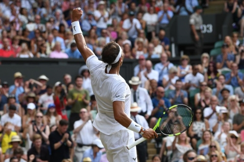 Spain's Rafael Nadal celebrates beating Russia's Karen Khachanov during their men's singles third round match on the fifth day of the 2017 Wimbledon Championships at The All England Lawn Tennis Club in Wimbledon, southwest London, on July 7, 2017. / AFP PHOTO / Glyn KIRK / RESTRICTED TO EDITORIAL USE (Photo credit should read GLYN KIRK/AFP/Getty Images)