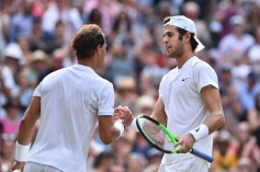 Russia's Karen Khachanov (R) shakes hands with Spain's Rafael Nadal (L) after Nadal won their men's singles third round match on the fifth day of the 2017 Wimbledon Championships at The All England Lawn Tennis Club in Wimbledon, southwest London, on July 7, 2017. / AFP PHOTO / Glyn KIRK / RESTRICTED TO EDITORIAL USE (Photo credit should read GLYN KIRK/AFP/Getty Images)