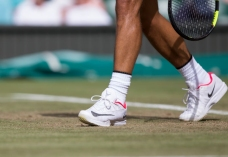 July 7th 2017, All England Lawn Tennis and Croquet Club, London, England; The Wimbledon Tennis Championships, Day 5; The Nike tennis shoes of Rafael Nadal (ESP) as he walks to his seat during his match against Karen Khachanov (RUS) (Photo by Roland Harrison/Action Plus via Getty Images)