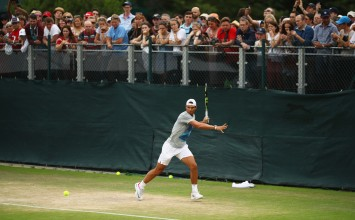 Fans look on as Rafael Nadal of Spain plays a forehand during a training session on day two of the Wimbledon Lawn Tennis Championships at the All England Lawn Tennis and Croquet Club on July 4, 2017 in London, England. (July 3, 2017 - Source: Julian Finney/Getty Images Europe)