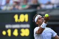 Spain's Rafael Nadal serves against Australia's John Millman during their men's singles first round match on the first day of the 2017 Wimbledon Championships at The All England Lawn Tennis Club in Wimbledon, southwest London, on July 3, 2017. / AFP PHOTO / Glyn KIRK / RESTRICTED TO EDITORIAL USE (July 2, 2017 - Source: AFP)
