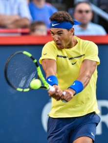 Rafael Nadal of Spain hits a return against Borna Coric of Croatia during day six of the Rogers Cup presented by National Bank at Uniprix Stadium on August 9, 2017 in Montreal, Quebec, Canada. (Aug. 8, 2017 - Source: Minas Panagiotakis/Getty Images North America)