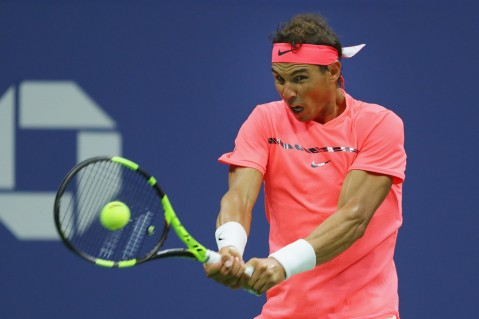 Rafael Nadal of Spain returns a shot to Dusan Lajovic of Serbia & Montenegro during their first round Men's Singles match on Day Two of the 2017 US Open at the USTA Billie Jean King National Tennis Center on August 29, 2017 in the Flushing neighborhood of the Queens borough of New York City. (Aug. 28, 2017 - Source: Richard Heathcote/Getty Images North America)