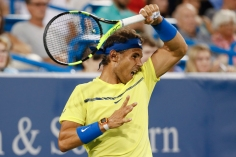 Rafael Nadal, of Spain, returns to Nick Kyrgios, of Australia, at the Western & Southern Open tennis tournament, Friday, Aug. 18, 2017, in Mason, Ohio. (AP Photo/John Minchillo)