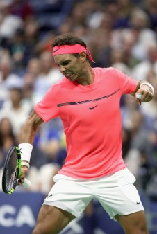 Rafael Nadal of Spain changes shirts during a break against Dusan Lajovic of Serbia & Montenegro during their first round Men's Singles match on Day Two of the 2017 US Open at the USTA Billie Jean King National Tennis Center on August 29, 2017 in the Flushing neighborhood of the Queens borough of New York City. (Aug. 28, 2017 - Source: Richard Heathcote/Getty Images North America)
